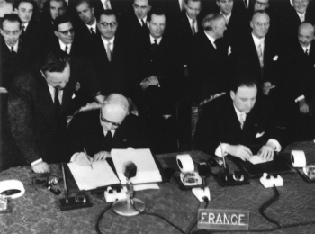 Maurice Faure (right) signing the Treaty of Rome