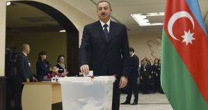 Azerbaijan's president Ilham Aliyev casts his ballot at a polling station during the parliamentary election in Baku, Azerbaijan.