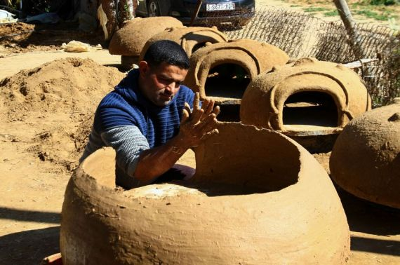 A Palestinian man from the Gaza Strip makes traditional clay oven to revive the forgotten heritage.