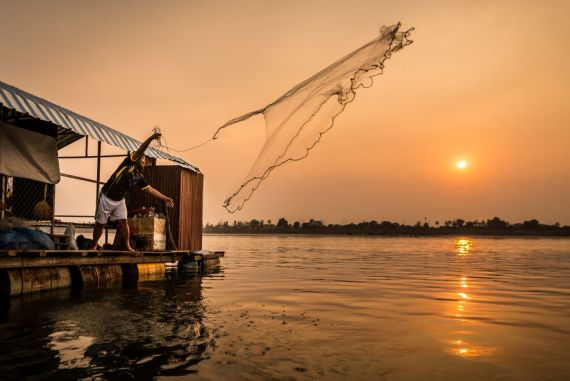 Sunset fishing on Mekong River