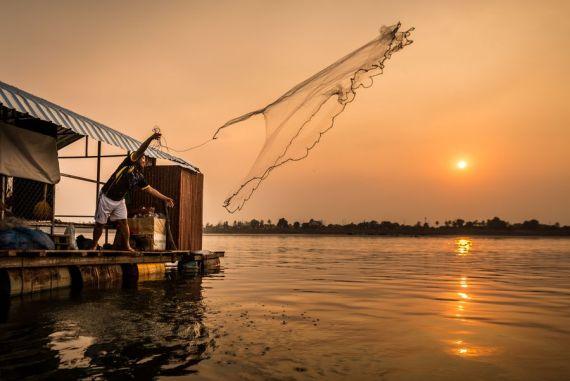 Sunset fishing on Mekong River